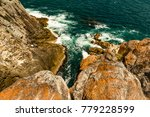looking down at the crashing... | Shutterstock . vector #779228599