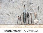 old tool standing on wooden... | Shutterstock . vector #779241061
