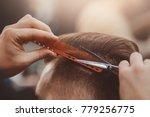 close up  master hairdresser... | Shutterstock . vector #779256775