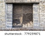 old wooden door in stone wall | Shutterstock . vector #779259871