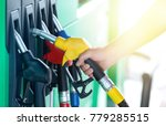 a colorful petrol pump filling... | Shutterstock . vector #779285515