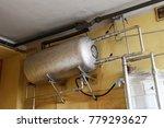 vintage hot water tank in an... | Shutterstock . vector #779293627