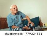 senior man with osteoarthritis... | Shutterstock . vector #779324581