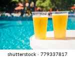 two glasses of beer on the... | Shutterstock . vector #779337817