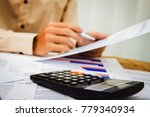 hand man writing tax on desk... | Shutterstock . vector #779340934