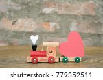train with heart on stone wall... | Shutterstock . vector #779352511