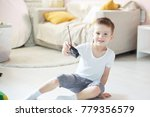 a boy playing with a car remote | Shutterstock . vector #779356579