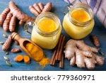 turmeric latte and fresh... | Shutterstock . vector #779360971