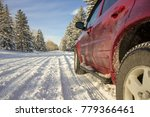 Close up of the side of a red SUV on a snowy road, alley - stock photo