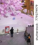 Small photo of TOKYO, JAPAN - DECEMBER 21ST, 2017. Shoppers admiring the huge Christmas tree in Kitte shopping mall.
