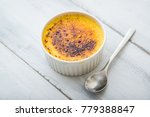 cream brulee on white background | Shutterstock . vector #779388847