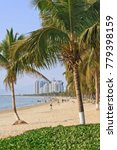Small photo of View on a beach in tropical with pal trees, Sanya, Hainan Island, China