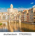colorful houses along the river ... | Shutterstock . vector #779399011