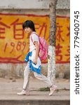 Small photo of SANYA-JAN. 11, 2012. Chinese girl walks back home after school. China has a traditional bias for sons. Many families abort female fetuses and abandon baby girls to ensure their one child is a son.