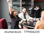 happy hispanic woman raising... | Shutterstock . vector #779406235