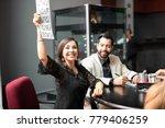pretty young woman winning a... | Shutterstock . vector #779406259