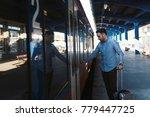 man opening the door of the...   Shutterstock . vector #779447725