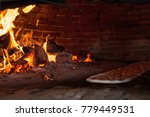 brick oven heating with wood... | Shutterstock . vector #779449531