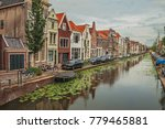 tree lined long canal with... | Shutterstock . vector #779465881