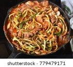 zucchini or zoodle spaghetti in ... | Shutterstock . vector #779479171