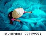 vietnam fishermen are repairing ... | Shutterstock . vector #779499031