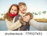 cute happy kids taking a selfie ... | Shutterstock . vector #779527651