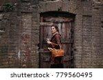 beautiful young girl in a... | Shutterstock . vector #779560495