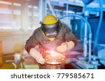 worker with protective mask... | Shutterstock . vector #779585671