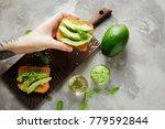 woman holding delicious avocado ... | Shutterstock . vector #779592844