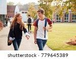 teenage students walking around ... | Shutterstock . vector #779645389