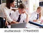 female teacher helping pupil...   Shutterstock . vector #779645455