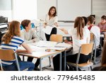 teenage students studying in... | Shutterstock . vector #779645485