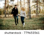 lovely couple holding hands and ...   Shutterstock . vector #779653561