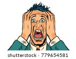 frightened man two hands on the ... | Shutterstock .eps vector #779654581