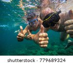 couple swimming underwater in... | Shutterstock . vector #779689324