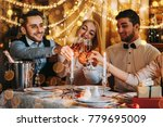 friends celebrating christmas... | Shutterstock . vector #779695009
