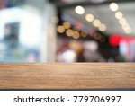 empty wooden table in front of... | Shutterstock . vector #779706997