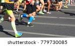 marathon runner legs running on ... | Shutterstock . vector #779730085