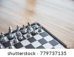 gold and silver chessmen on... | Shutterstock . vector #779737135