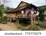 stilt house made of waddle and... | Shutterstock . vector #779775079