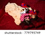 kids in pajamas play in bed on... | Shutterstock . vector #779795749