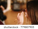 girl doing makeup | Shutterstock . vector #779807905