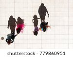 people walking shot from above... | Shutterstock . vector #779860951