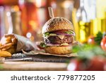 close up on a yummy burger on a ... | Shutterstock . vector #779877205
