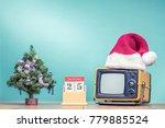 retro tv in santa's hat ... | Shutterstock . vector #779885524