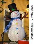 Small photo of BROMONT QUEBEC CANADA 12 12 17: A snowman is an anthropomorphic snow sculpture. In many places, typical snowmen consist of three large snowballs of different sizes with some additional accoutrements