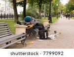 Drunk Man Sleeping On Park Bench