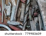 Small photo of Hammer, drill and other different hard metal master tools in the workshop in a toolbox