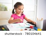 little girl painting picture at ... | Shutterstock . vector #780104641