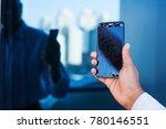 hand holding a broken phone | Shutterstock . vector #780146551
